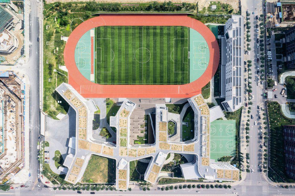 5437404ac07a80f87c000075_beijing-no-4-high-school-fangshan-campus-open-architecture_ext001_aerial__u00a9xia_zhi