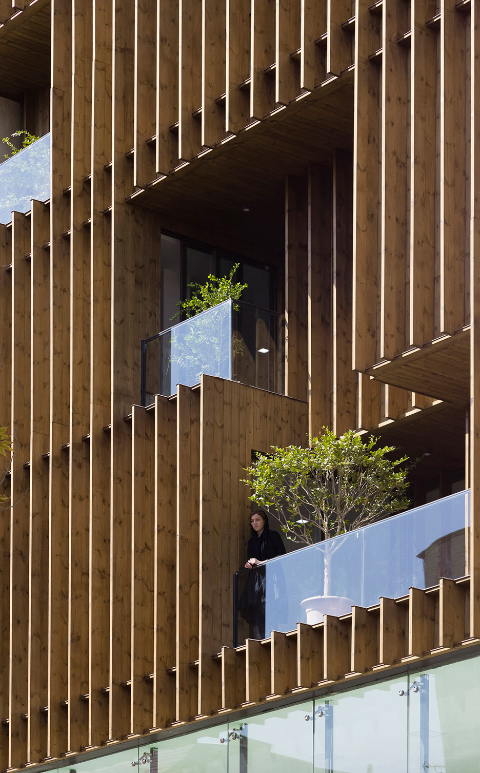 office-block-tehran-lp2-architecture-studio-iran-commercial-facade-connection-relationship-interior-exterior-wood_dezeen_936_0