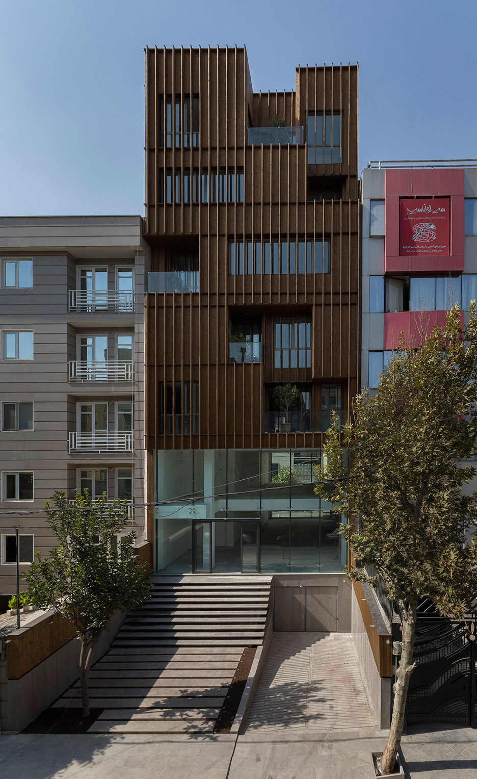 office-block-tehran-lp2-architecture-studio-iran-commercial-facade-connection-relationship-interior-exterior-wood_dezeen_936_3